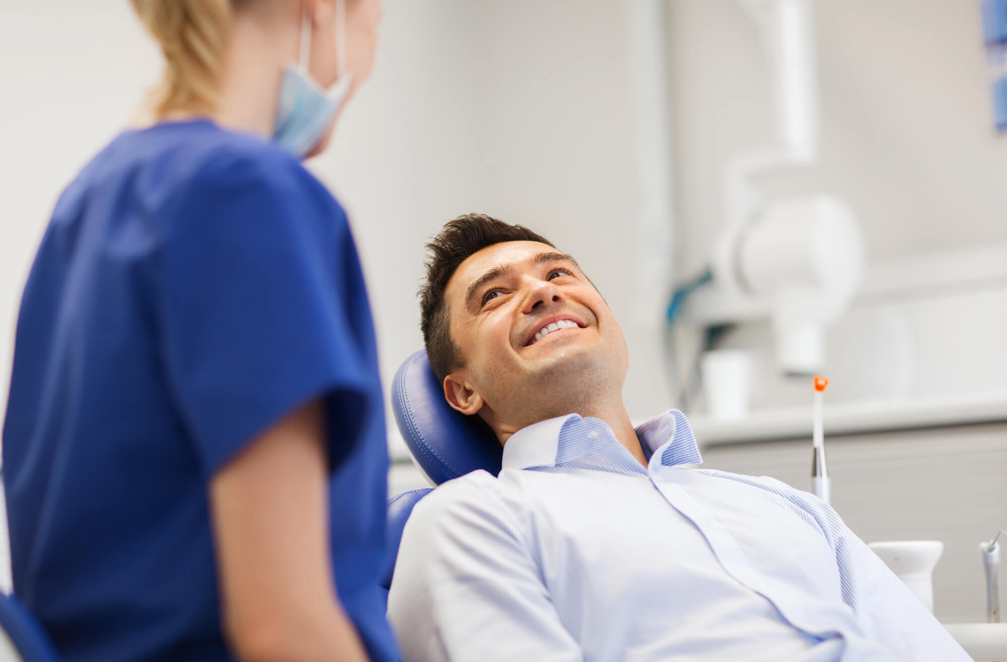 Male patient smiling at a sedation dentist in Mechanicsville
