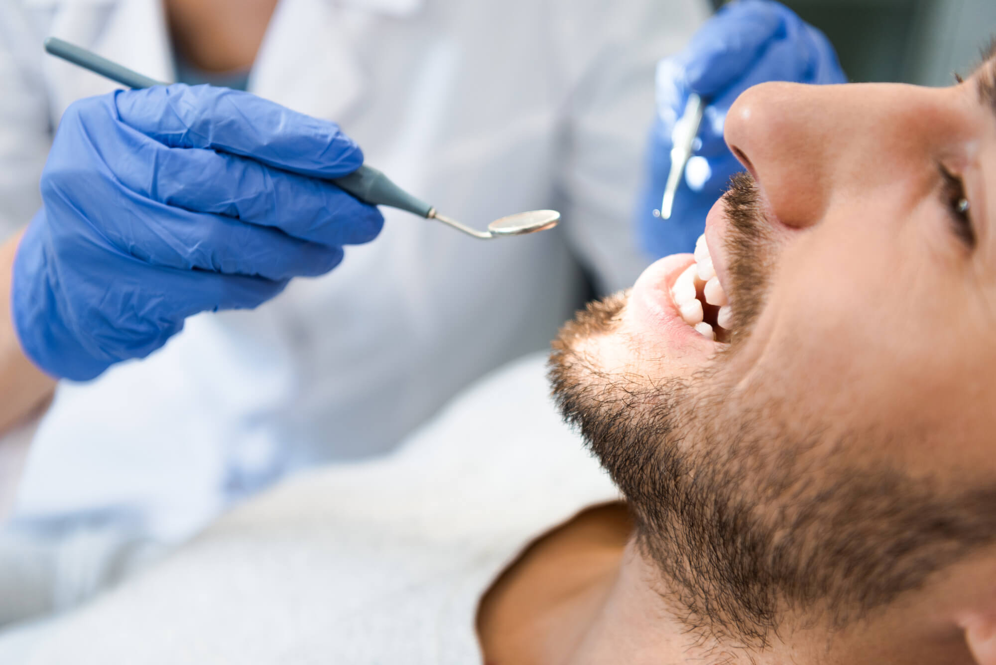 Cropped shot of dentist examining for root canal procedure and Sedation Endodontist in 23226